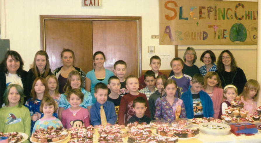 Photo of Junior Church children with cupcakes they made to raise money for Sleeping Children Around the World.